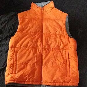 Orange and grey reversible puffy vest